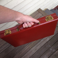 Light brown leather briefcase with brass details