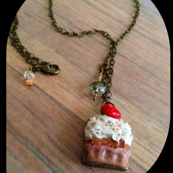 Long necklace with strawberry shortcake pendant & glass bronze tone
