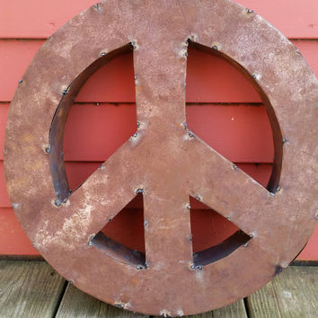 Metal Peace sign hand crafted from recycled tin