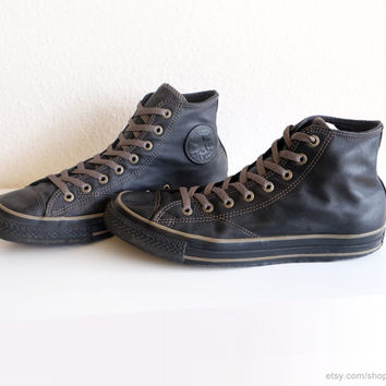 Black leather vintage Converse All Stars, high tops with bronze- and khaki details, new laces. Size eu 44 (UK 10, US mens 10, US wo's 12)