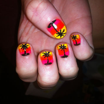 Colorful sunset palm tree painted design on false nails