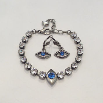 SWAROVSKI CRYSTAL BRACELET, earring set, evil eye, fashion forward, fun jewelry, designer inspired, sapphire, diamond crystal