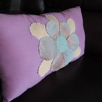 Blossom is a handmade, hand-appliqued, decorative throw pillow.