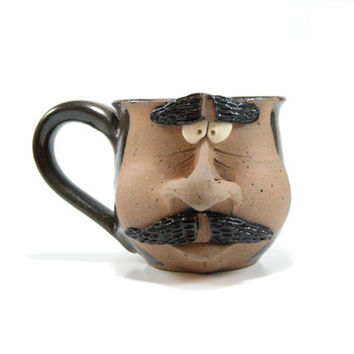 Dark brown pottery face mug, stoneware coffee cup, ceramic mug