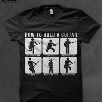How To Hold A Guitar T-Shirt Pre-Orders