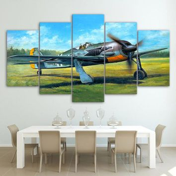 Military vintage airplane plane take-off on green grass wall art on canvas