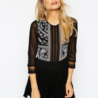 ASOS Woven Playsuit With White Embroidery at asos.com