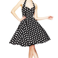 Stay fresh and girly with the Spring Potion Mariam 50's Pinup Dress by Hell Bunny. This sleeveless dress features large scale white polka dot print throughout against with black background, sweetheart neckline with seams over bust for shaping, adjustable t