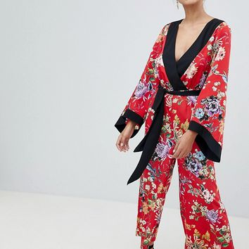 ASOS DESIGN kimono jumpsuit with tipping in floral at asos.com