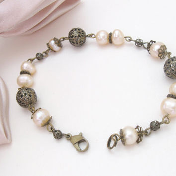 Art deco pearl bracelet with bronze filigree beads