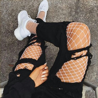 Black temptation conjoined sexy fishnet stockings tights ripped jeans