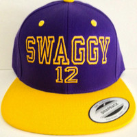 SWAGGY12 JUSTIN Bieber Under brim of hat BELIEVE
