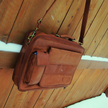 vintage 1980s cognac leather foam padded briefcase. cognac brown leather messenger. brown leather messenger. distressed satchel