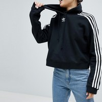 adidas Originals adicolor Three Stripe Cropped Hoodie In Black at asos.com