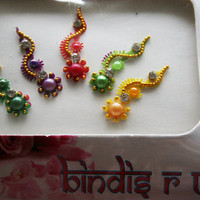 Christmas Bindis Jewels with Swirl design gold bead crystal.