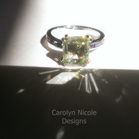 Emerald Cut and Blue Sapphire Baguette Engagement Ring by Carolyn Nicole Designs