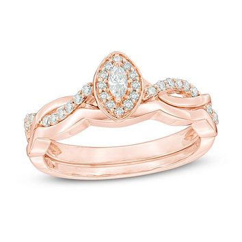1/4 CT. T.W. Marquise Diamond Frame Twist Bridal Engagement Ring Set in 14K Rose Gold