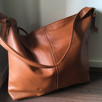 Tan Leather Tote Bag.Single strap with adjustable belt features.Quality, soft, shoulder bag. Real leather with long strap.Classic and simple