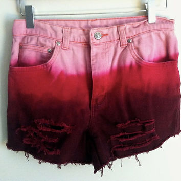 pink distressed high waisted cutoffs