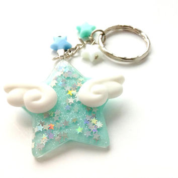 34e432883dca Blue Winged Star With White Angel Wings Keychain