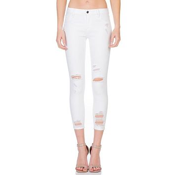 Mid Rise White Destroyed Skinny Jean