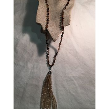 Nemesis Handmade Brown Striped Onyx and Crystal Tassel Necklace