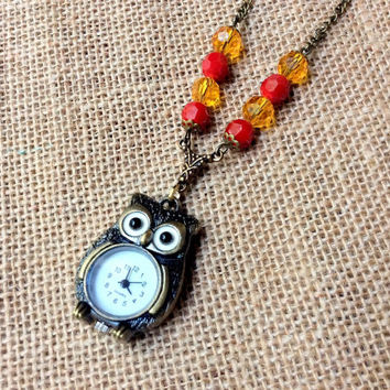 Snowy Owl Watch Necklace: owl watch with red and yellow crystal beads