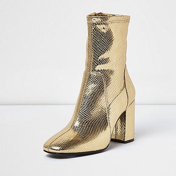 Gold sock boot with block heel