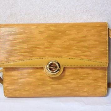 ESBYD9 Vintage Louis Vuitton rare yellow epi shoulder purse with gold tone turn lock closure.