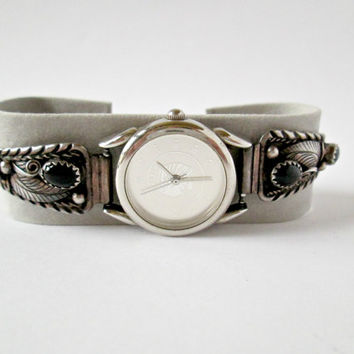 Vintage Women's Wristwatch Sterling Silver Black Onyx Southwest Band Stretch Band Silver Coin Dial Face Image Of Native American Indian Head