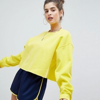 Reclaimed Vintage Inspired Overdyed Cropped Sweat With Raw Hem at asos.com