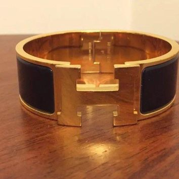 Hermes Gold And Black Clic H Bracelet Bangle Size Small PM Free Postage