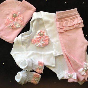 Newborn baby girl take home outfit complete with pink heart bodysuit, matching pants, hat and socks