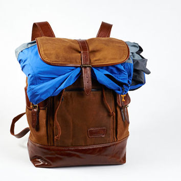 Waxed canvas backpack with leather straps and bottom. Tobacco brown canvas rucksack.