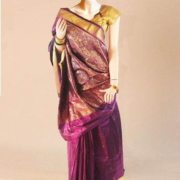 the pure silk saree in purple with intricate gold artwork