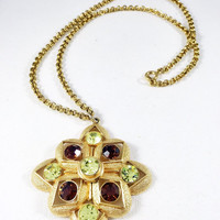 Vintage Maltese cross necklace, peridot Starburst necklace, austrian crystal, green and gold Sarah Coventry star pendant