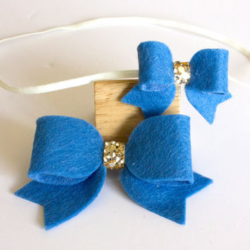 Matching headbands set - big sister/little sister. Blue and gold felt bow on skinny elastic