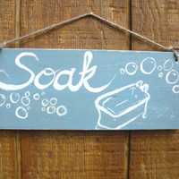 Soak-bathroom sign on wood