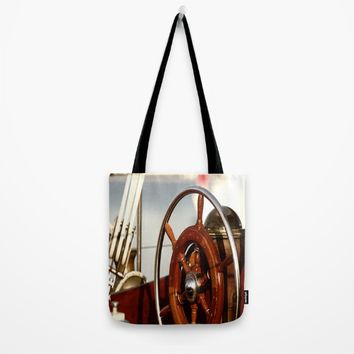 Staying on course at sea Tote Bag by Tanja Riedel