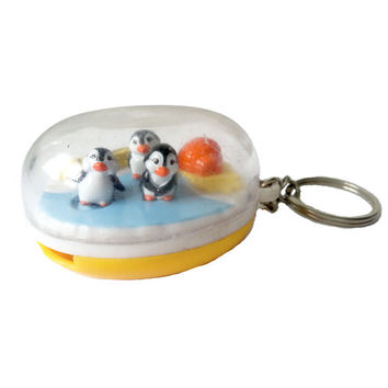 Vintage Penguins Keychain Egg wind up motion iceberg 90s plastic dome yellow