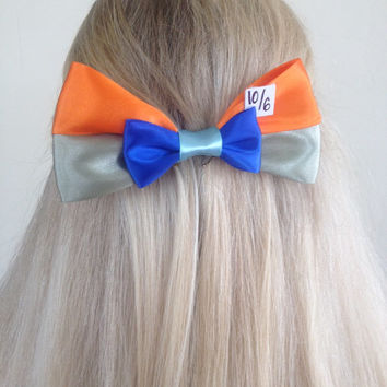 Mad Hatter Alice In Wonderlad Mad Tea Party Green and Orange Bow by Design Bowtique