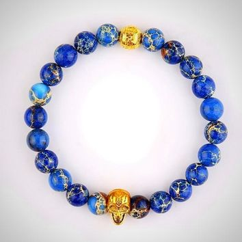 Natural Blue Stone Bead With Gold Color Skull Bracelet