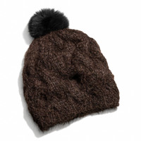 braided cable knit hat with fur pom