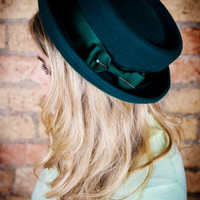 Ladies porkpie hat in forest green.