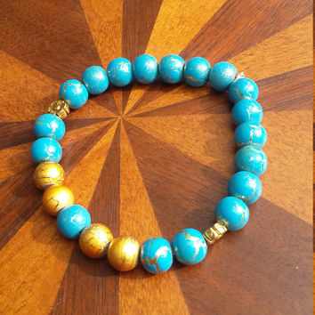 Blue and gold beaded stretch bracelet