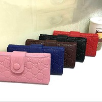 """Gucci"" Women Purse Simple Fashion Solid Color Double G Embossed Long Section  Button Three Fold Wallet"