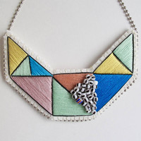 Small embroidered geometric bib necklace in beautiful multicolors of rose, yellow, blue and mint green with black and white glass beads