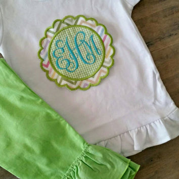 Appliqué scallop circle with monogram.  Matching ruffle pants.  Great for every occasion!