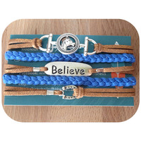 3 Charm Cuff Bracelet Silver charms horse bit, believe, and horseshoe. Metallic brown and cobalt suede
