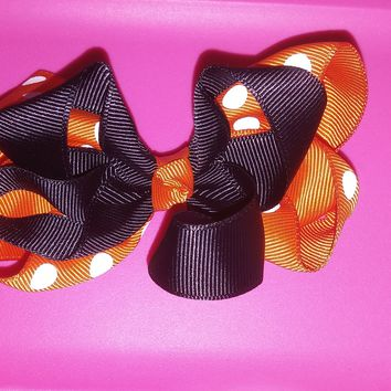 Black and orange with white dots big looped hair bow